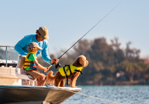A man, child, and dog on a boat