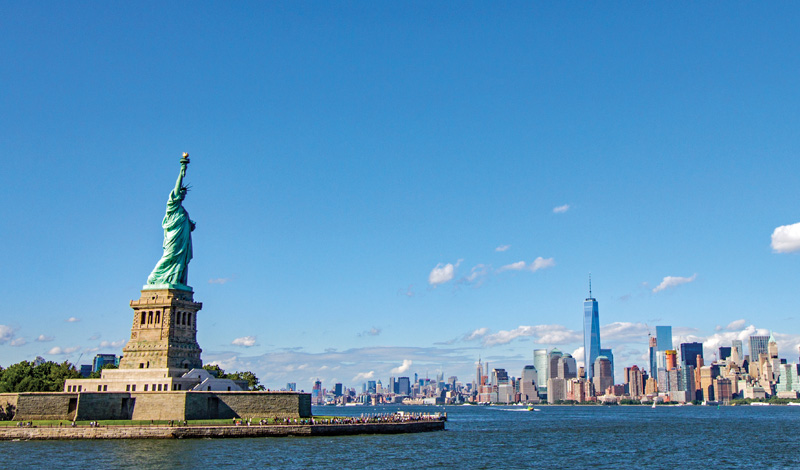 Ellis Island and the Statue of Liberty overlooking the NYC skyline