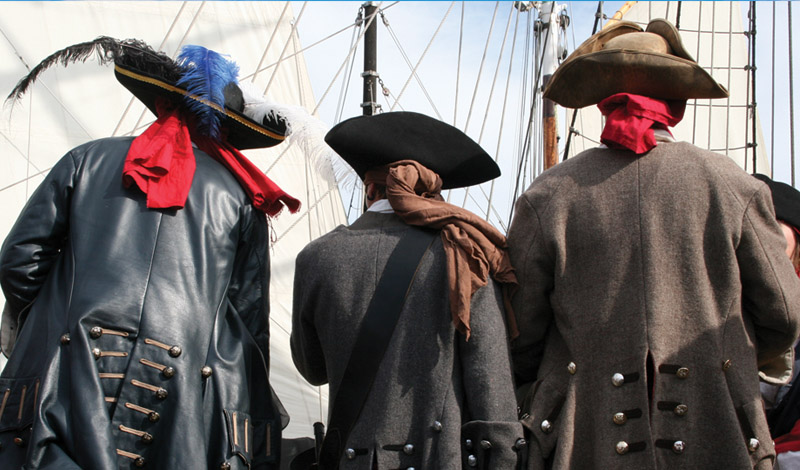 Backs of three pirates in Beaufort, NC