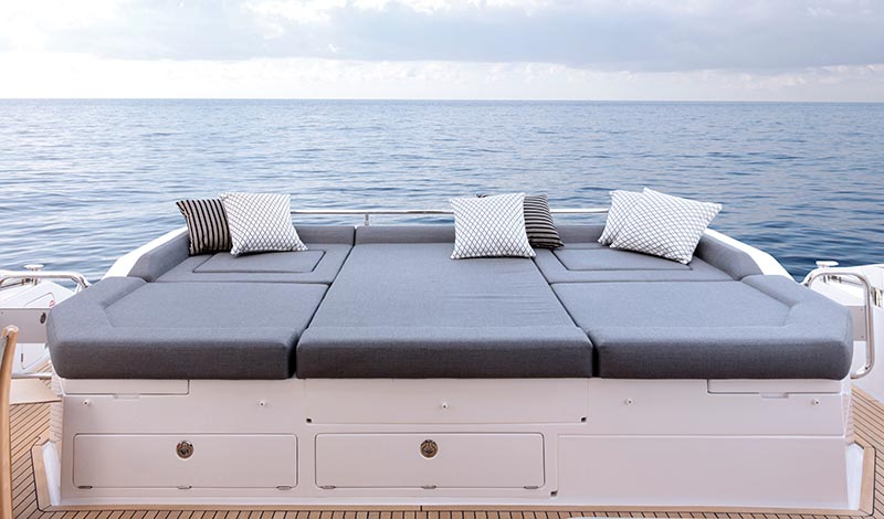 wide sun pad on the flybridge of a yacht overlook the open ocean