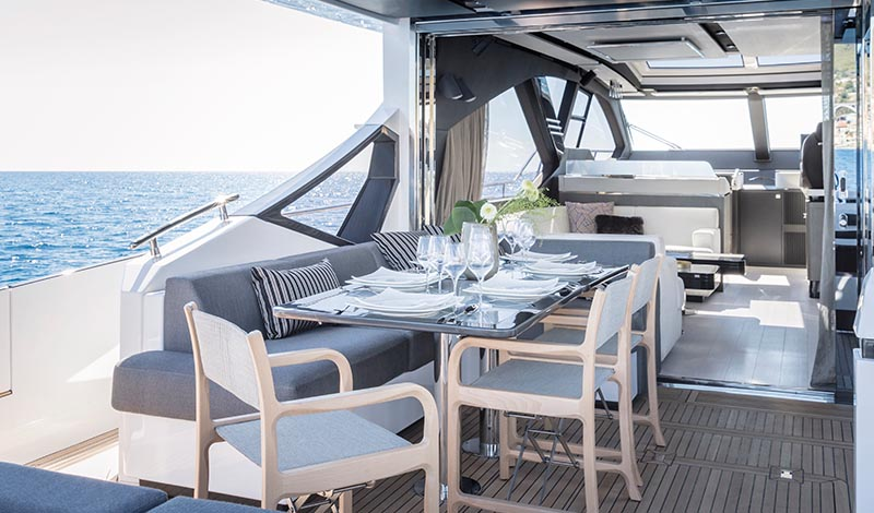a dining table on the deck of a yacht