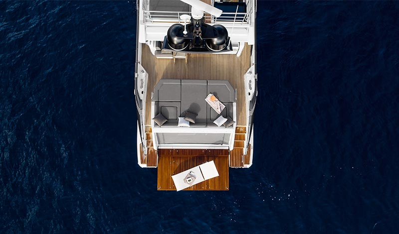 The aft deck of a large yacht in deep blue water