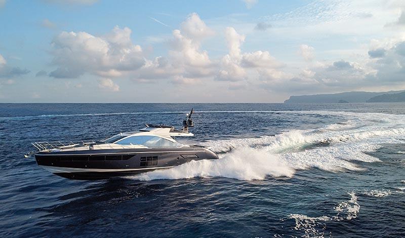 a large yacht turning creating a large wake during sunset