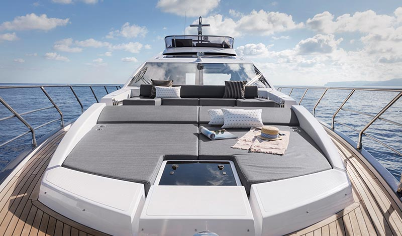 the bow of a large yacht with a sunpad