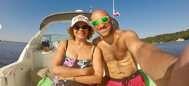 A man and woman smile for a selfie on a boat
