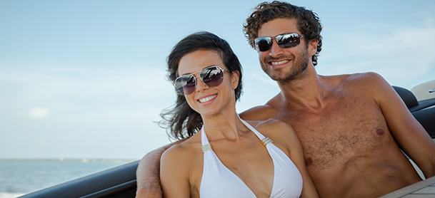 Couple smiling as they enjoy cruise on boat