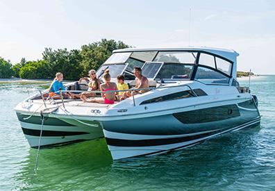 Family sitting on bow of Aquila 36 Power Catamaran