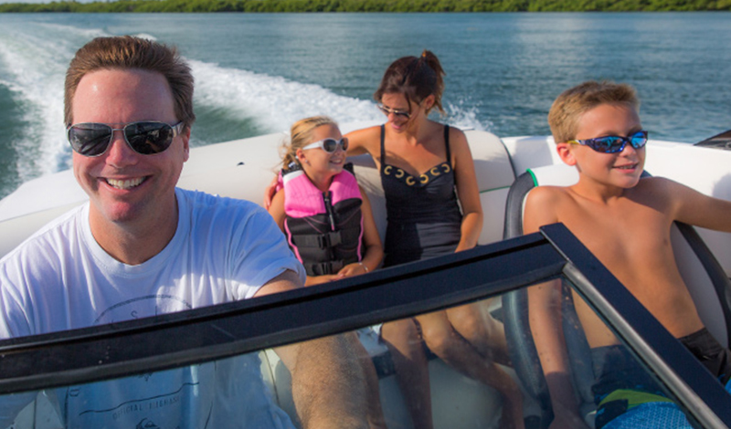family on sport boat