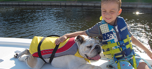 Child and dog having fun on a Sea Pro