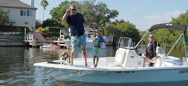 Family with dog on Sea Pro boat