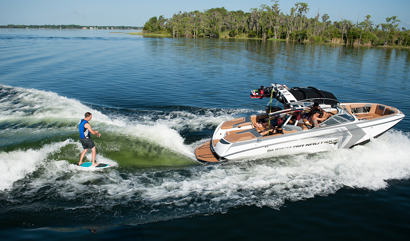 Surfer behind Nautique towboat