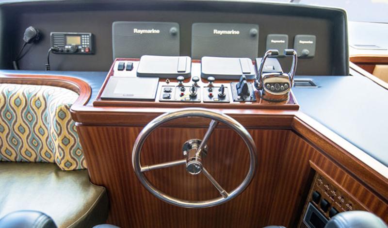 at the helm of an Ocean Alexander yacht