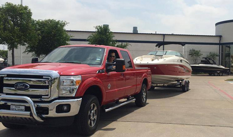 Truck towing Sea Ray sport boat