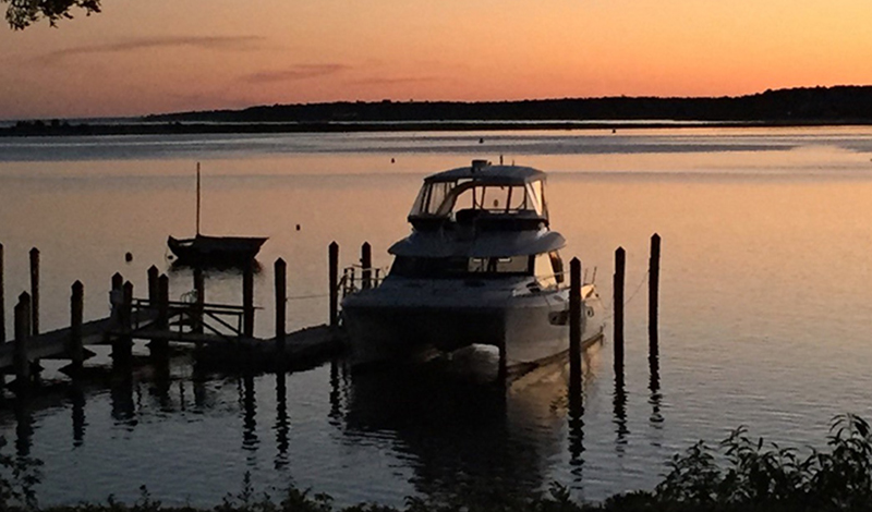 The Perfect Interlude docked at sunset