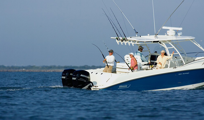 People fishing off a Boston Whaler in deep blue water