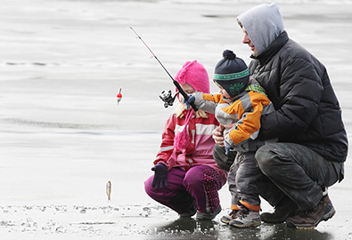 Father and kids ice fishing