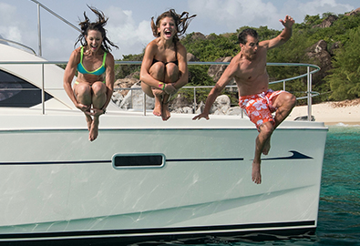 People jumping off side of Power Catamaran in the British Virgin Islands
