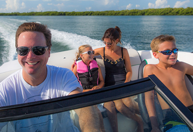 Family on boat cruising through water