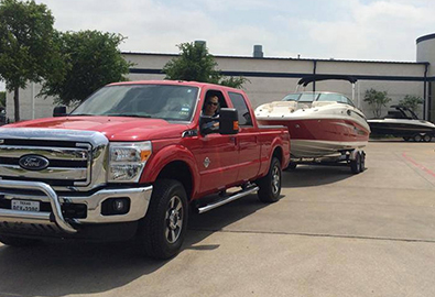 Keever family truck towing their sport boat