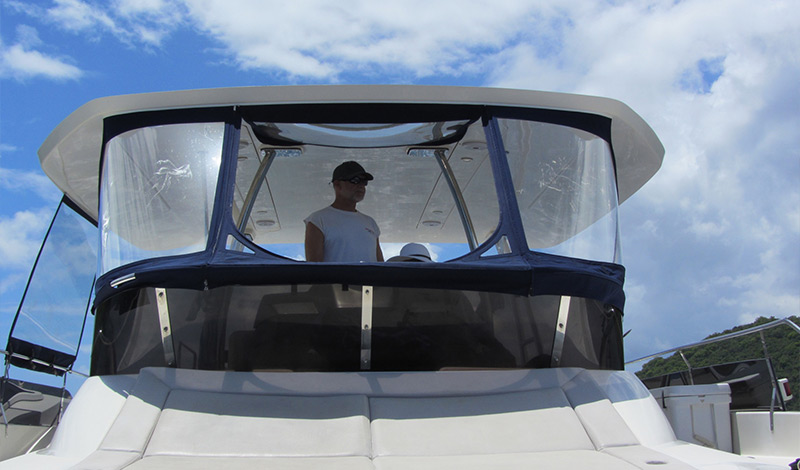 Captain on the flybridge of an MarineMax Vacations 484 in the British Virgin Islands