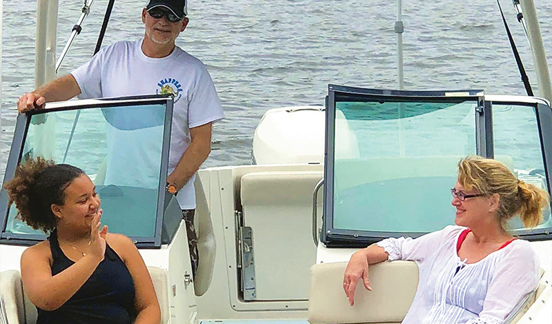 hale family cruising the water in their boston whaler vantage