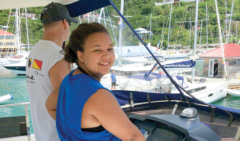 Father and daughter at the helm of a MarineMax Vacations 484 in the British Virgin Islands