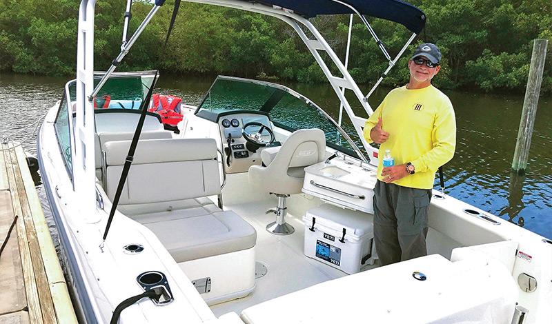 Mr. Hale in his Boston Whaler Vantage boat