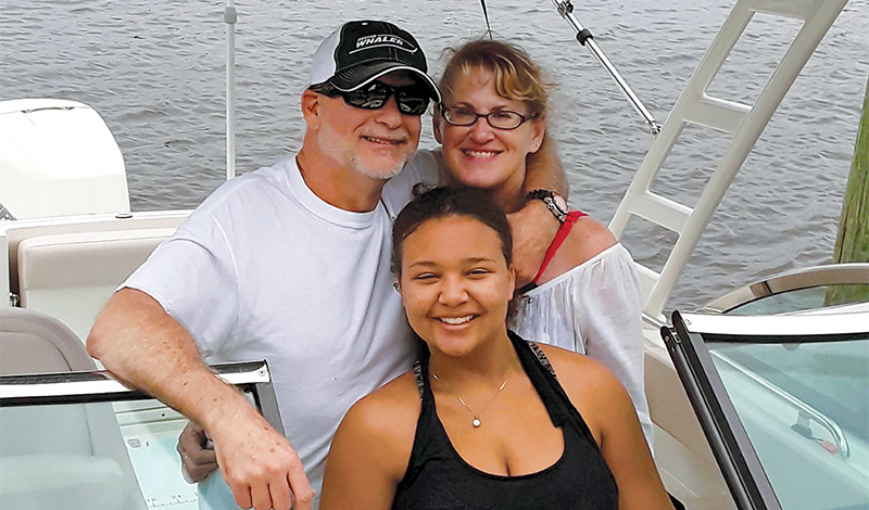 hale family on their boston whaler vangage boat smiling