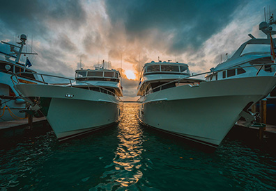 sun setting between boats