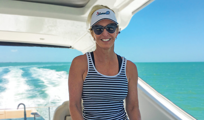 stacey captaining her sea ray