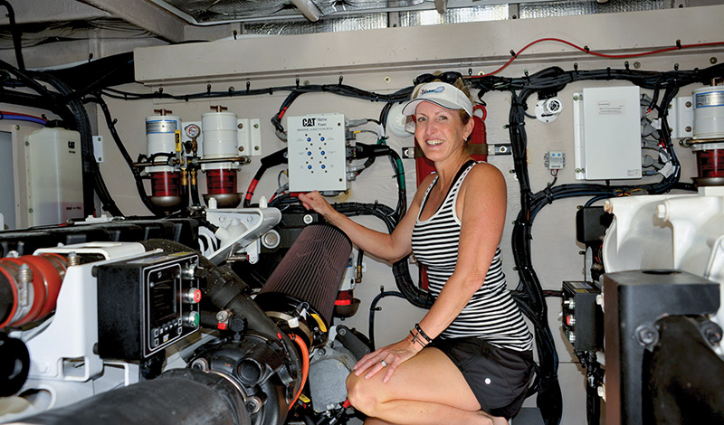 Stacey in the engine room of her Sea Ray