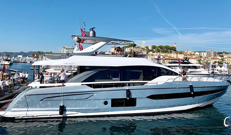 a profile view of an azimut yacht docked in cannes france on a sunny day