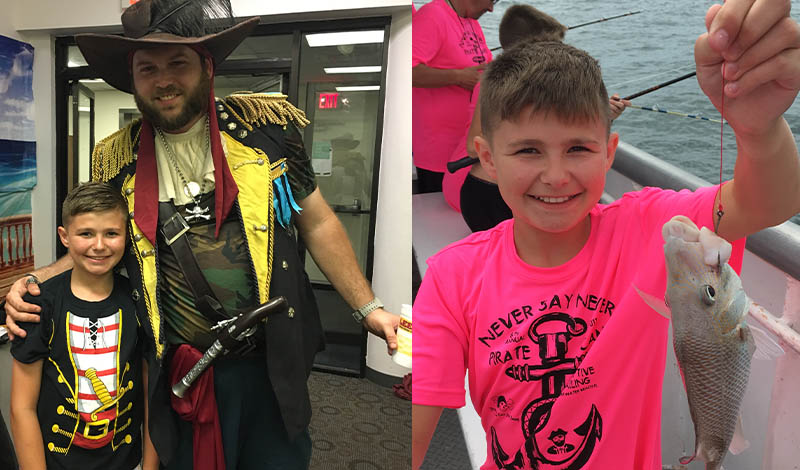 a boy in a pink shirt holding a fish and a boy smiling next to a man dressed as a pirate