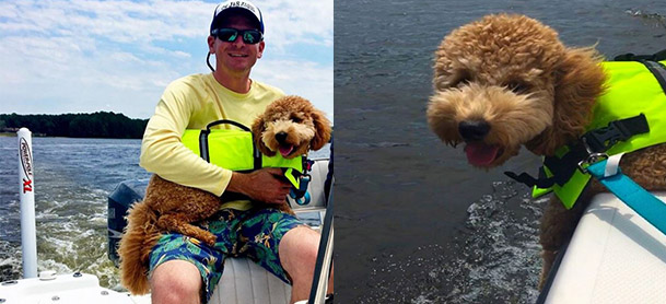 On left, a man holds a golden doodle in a green jacket while sitting on a boat. On right, a golden doodle leans over the side of a boat