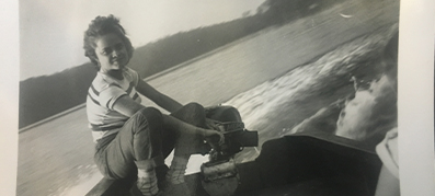 A woman boating on a Boston Whaler in black and white