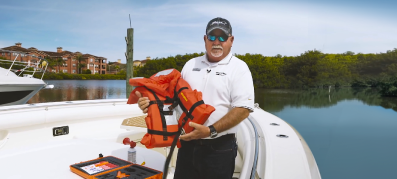 Boating Safety, a man holding a life jacket
