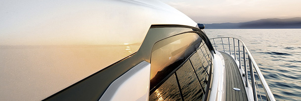 a close up starboard shot of the azimut atlantis 45  as the sun reflects off the glass