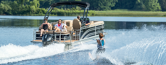 people waterskiing and having fun on a harris pontoon