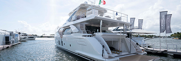 an azimut yacht docked at the fort lauderdale international boat show on a sunny day