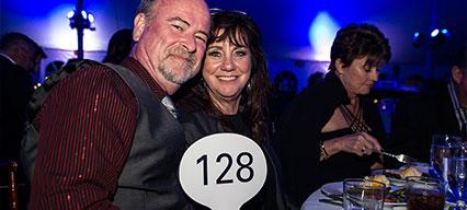 Couple bidding at MarineMax Fort Myers Yacht Gala