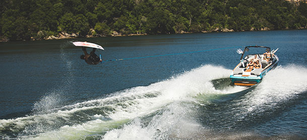 a wakeboarder in the air while being towed by a tige boat
