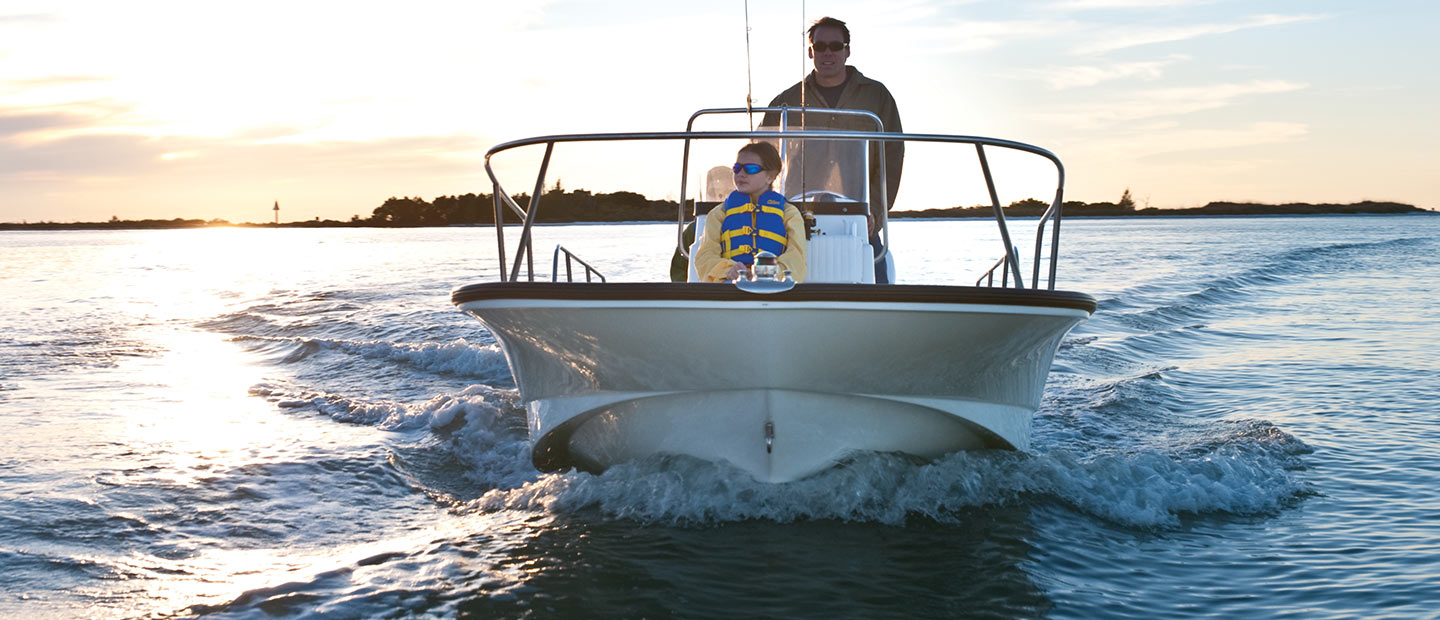 A front view of a Boston Whaler 170 Montauk cruising in calm waters