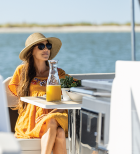 Woman having breakfast onboard of Aquila yacht
