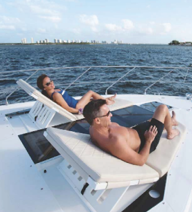 Couple lounging on a Cruisers Yacht