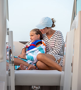 Mom with a daughter onboard of a Sailfish boat