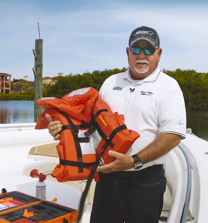 Captain holding a life jacket for boat safety