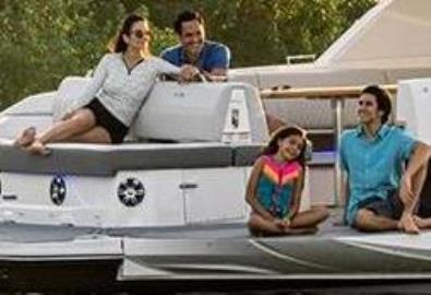 A family aboard an anchored boat