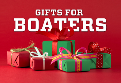 Christmas presents in front of a red background with the words Gifts for Boaters