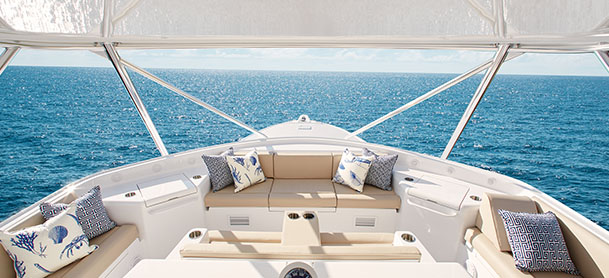 A white, clean, and organized boat deck