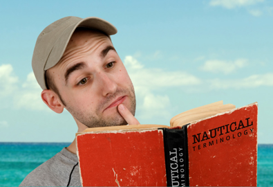 Man reading nautical terms dictionary